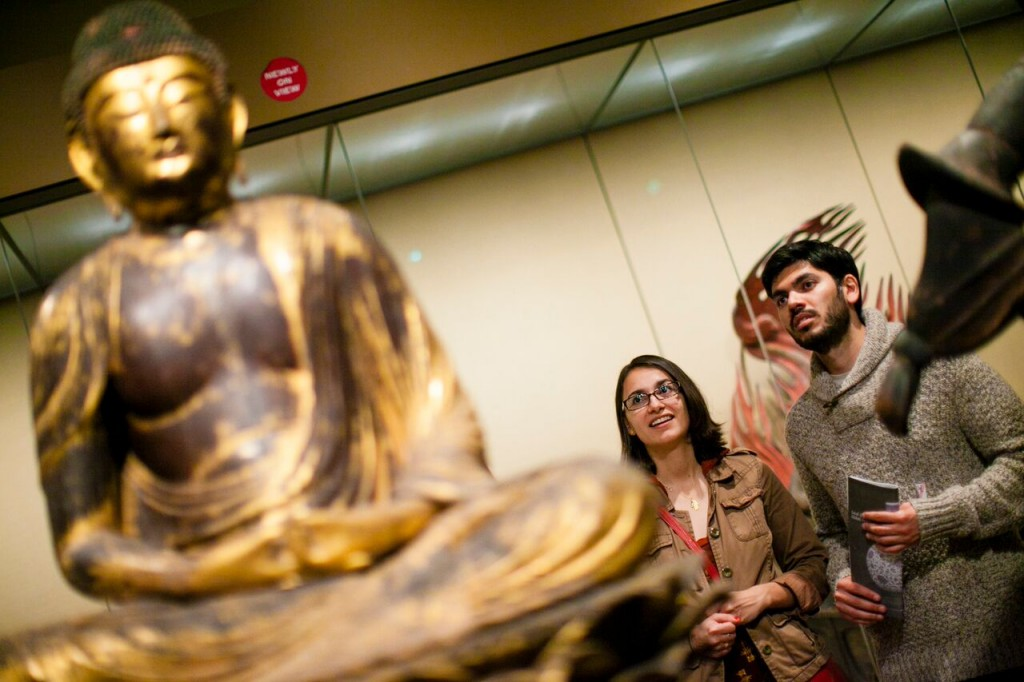 Golden Buddha with Visitors